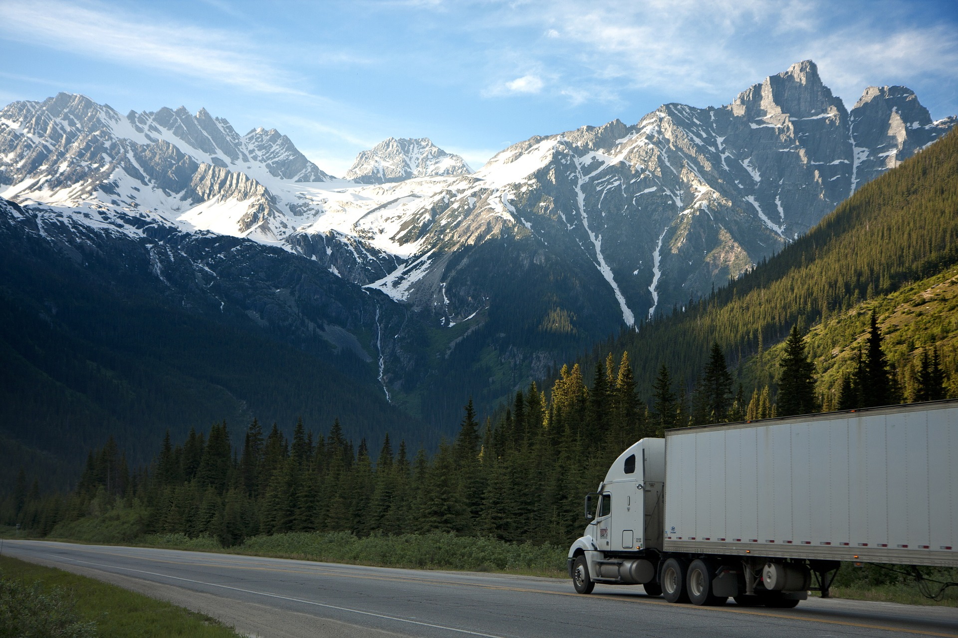 moving truck with mountains in the background